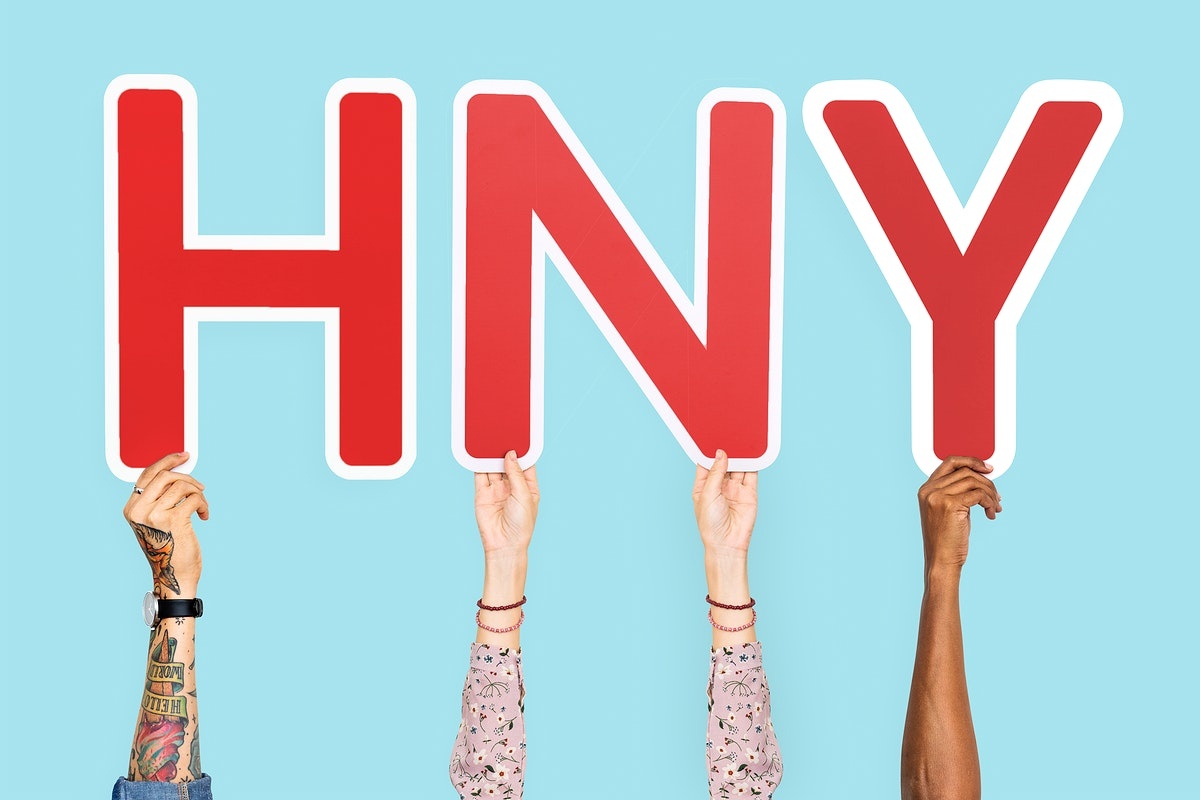 Hands holding the abbreviation HNY