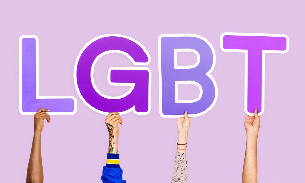 Hands holding the abbreviation LGBT