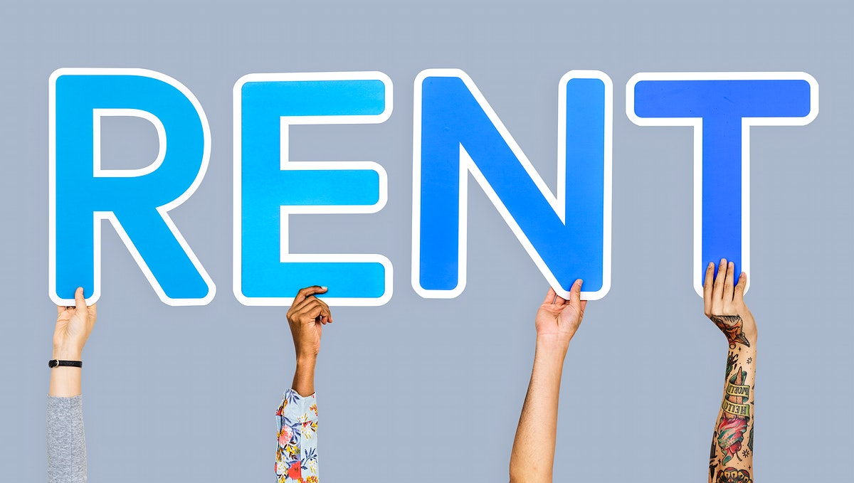 Hands holding the word rent