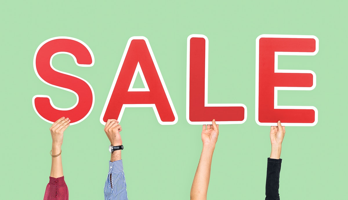 Hands holding the word sale
