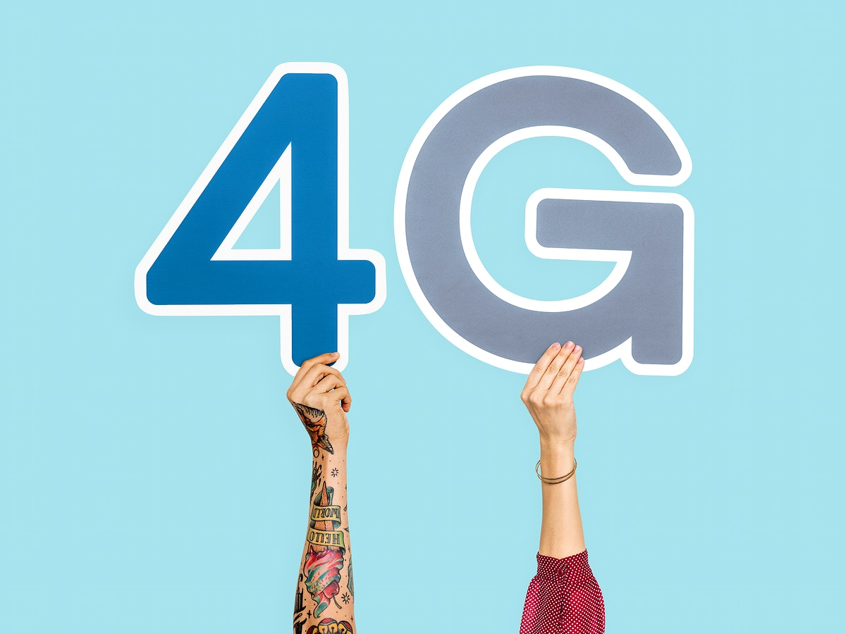 Hands holding up colorful letters forming the abbreviation 4G