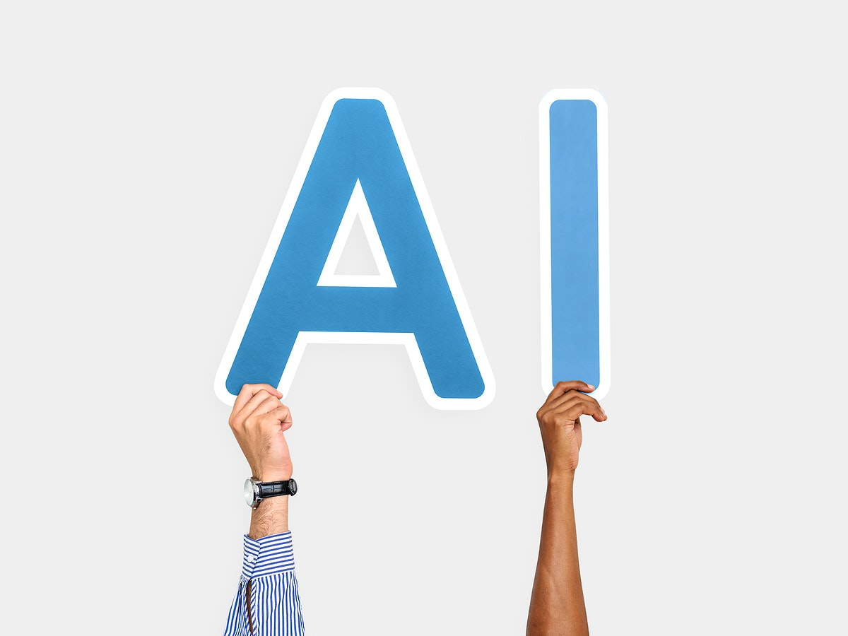 Hands holding up blue letters forming the abbreviation AI