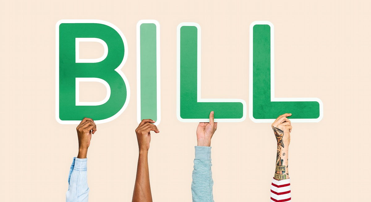 Hands holding up green letters forming the word bill