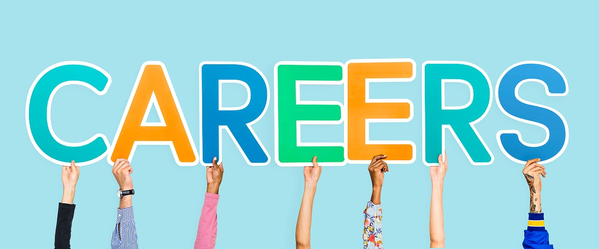 Hands holding up colorful letters forming the word careers