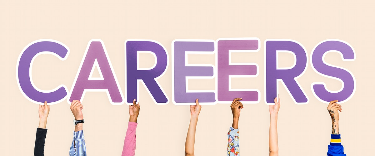 Hands holding up purple letters forming the word careers