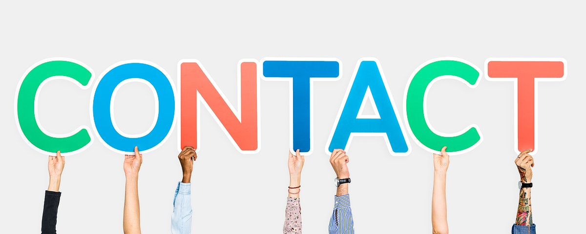 Hands holding up colorful letters forming the word contact