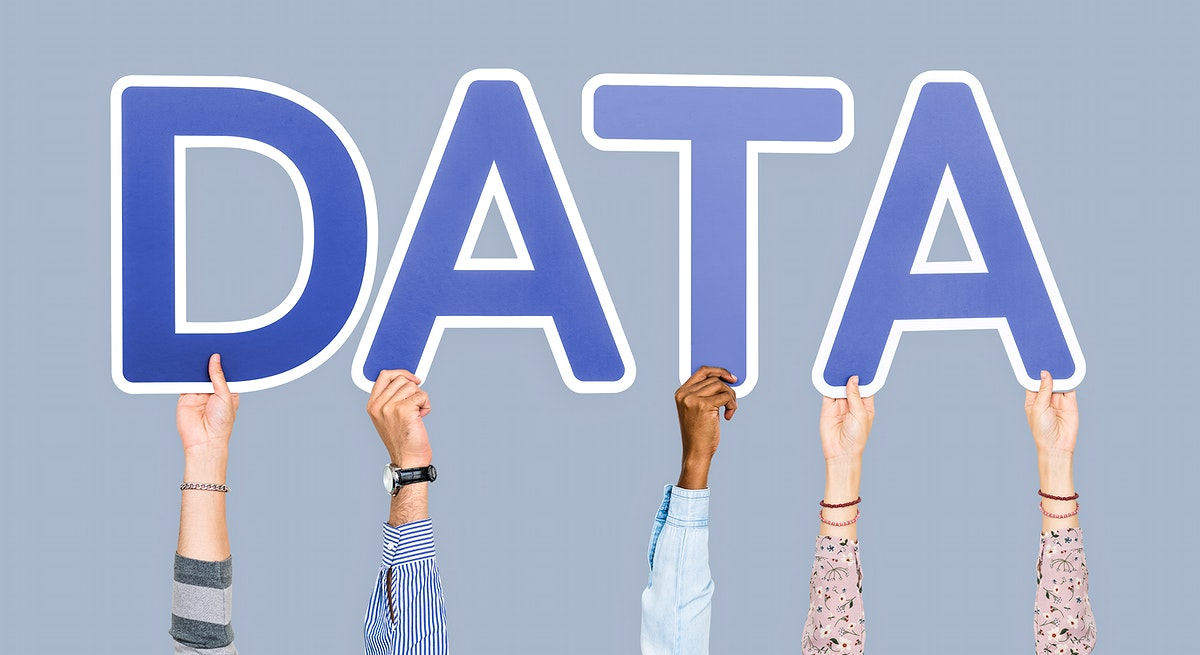Hands holding up blue letters forming the word data