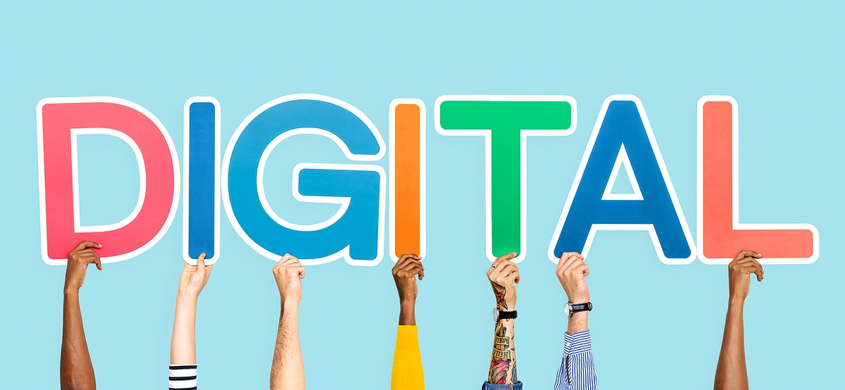 Hands holding up colorful letters forming the word digital