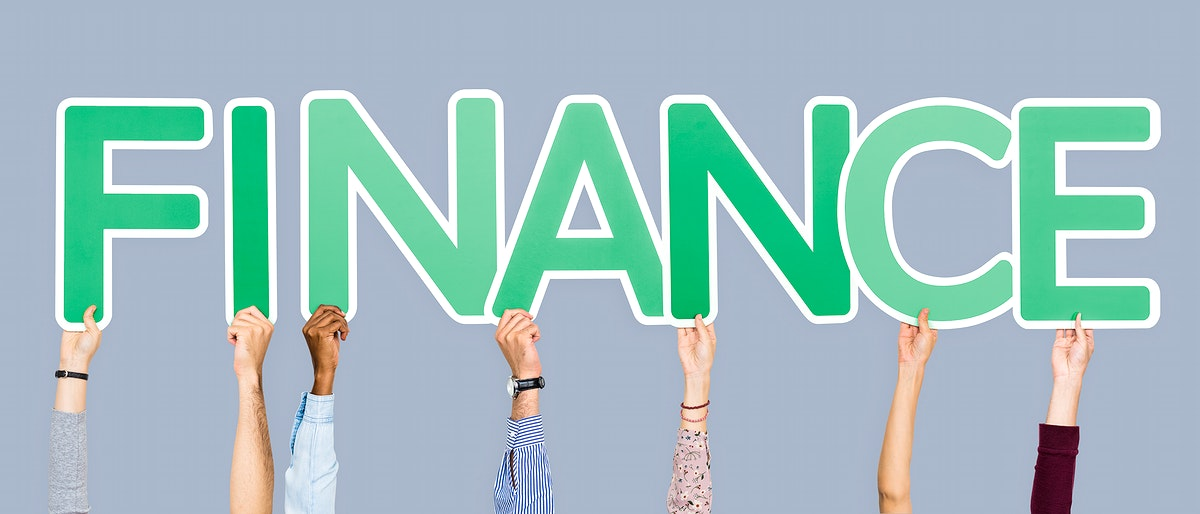Hands holding up green letters forming the word finance