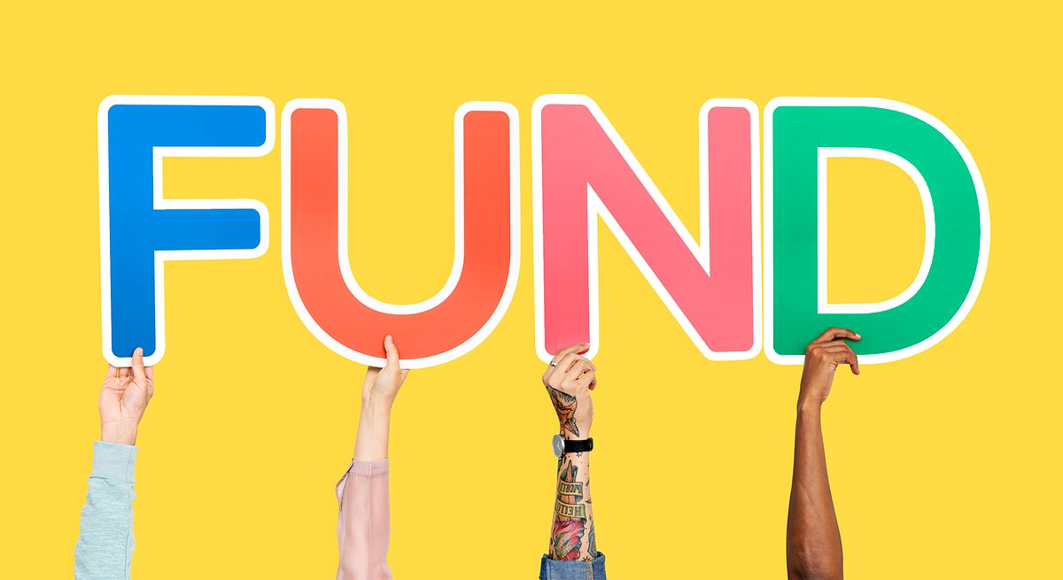Hands holding up colorful letters forming the word fund