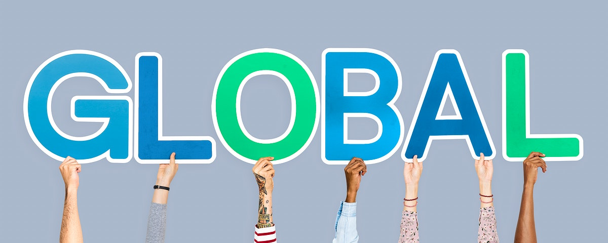 Hands holding up colorful letters forming the word global