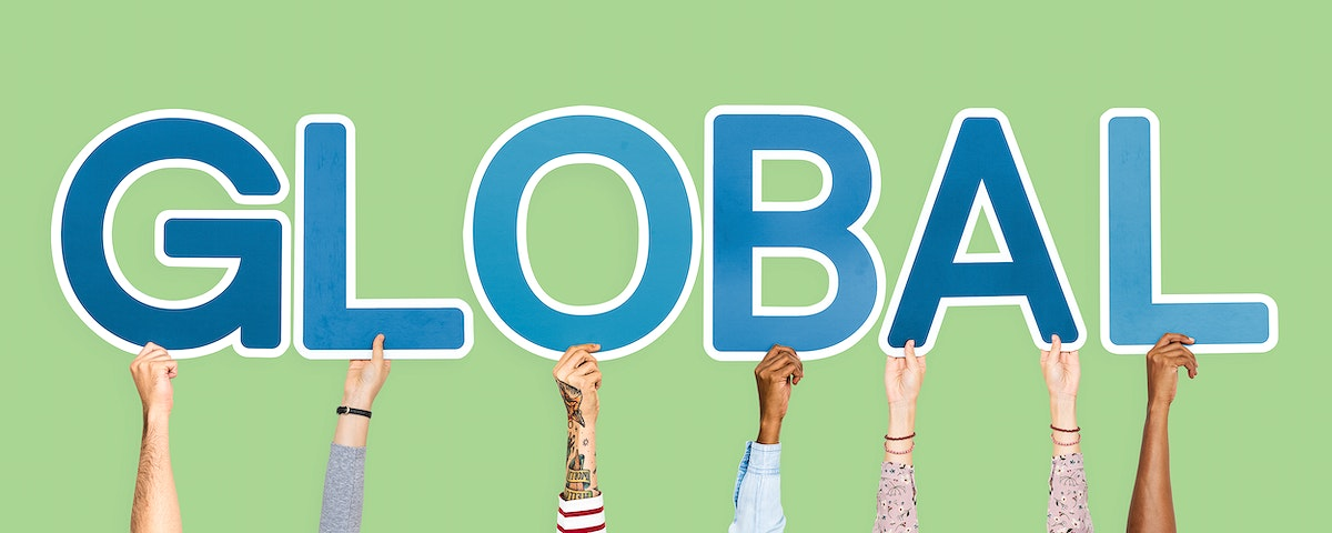 Hands holding up blue letters forming the word global