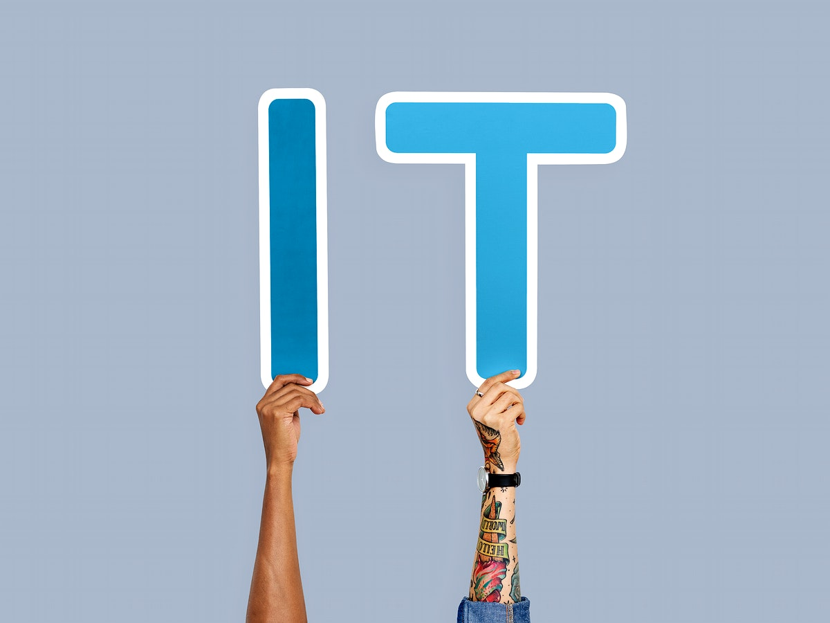 Hands holding up blue letters forming the abbreviation IT