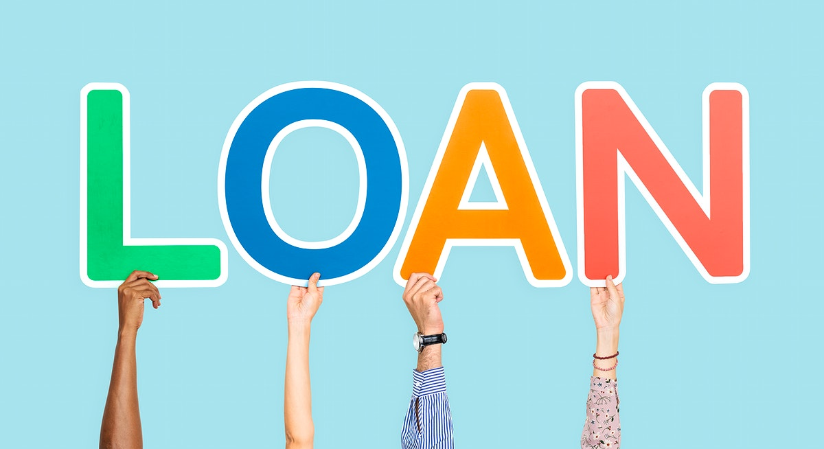 Hands holding up colorful letters forming the word loan
