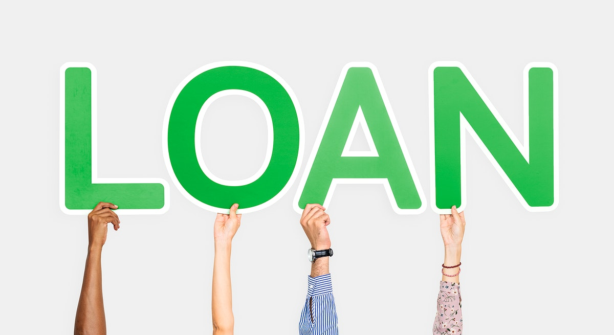 Hands holding up green letters forming the word loan