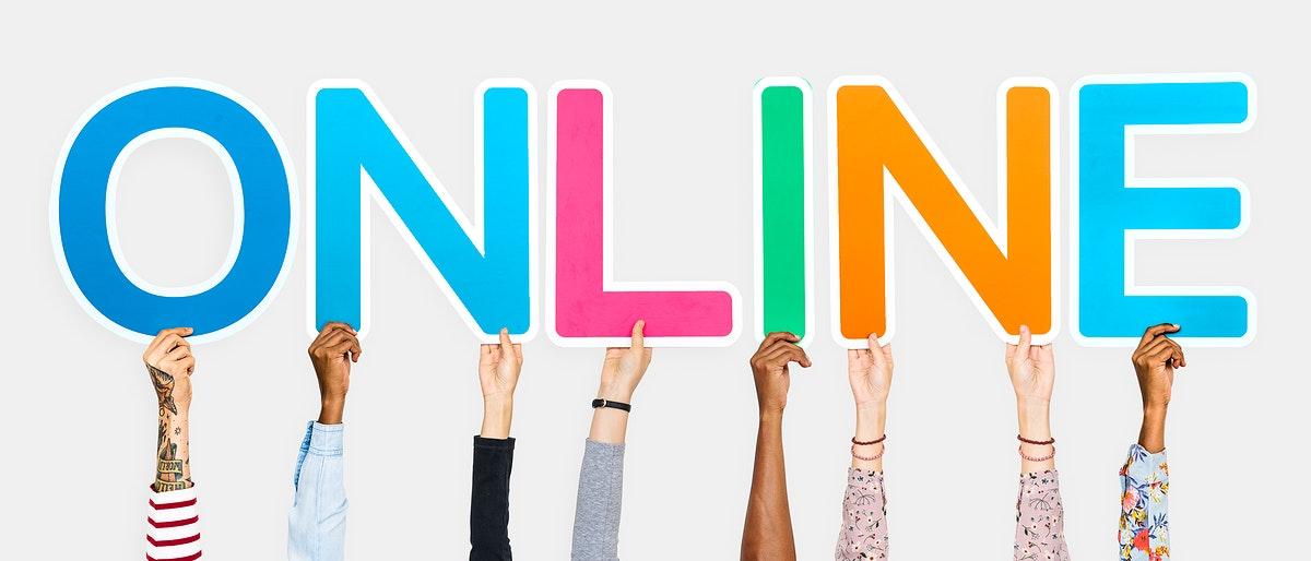 Hands holding up colorful letters forming the word online