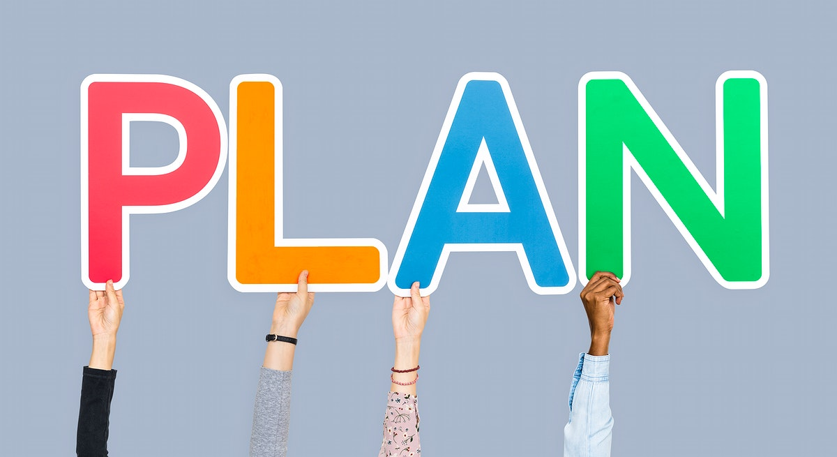 Hands holding up colorful letters forming the word plan