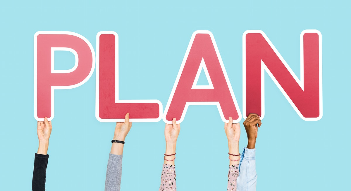 Hands holding up red letters forming the word plan