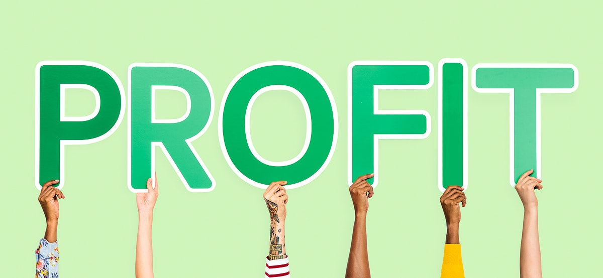 Hands holding up green letters forming the word profit