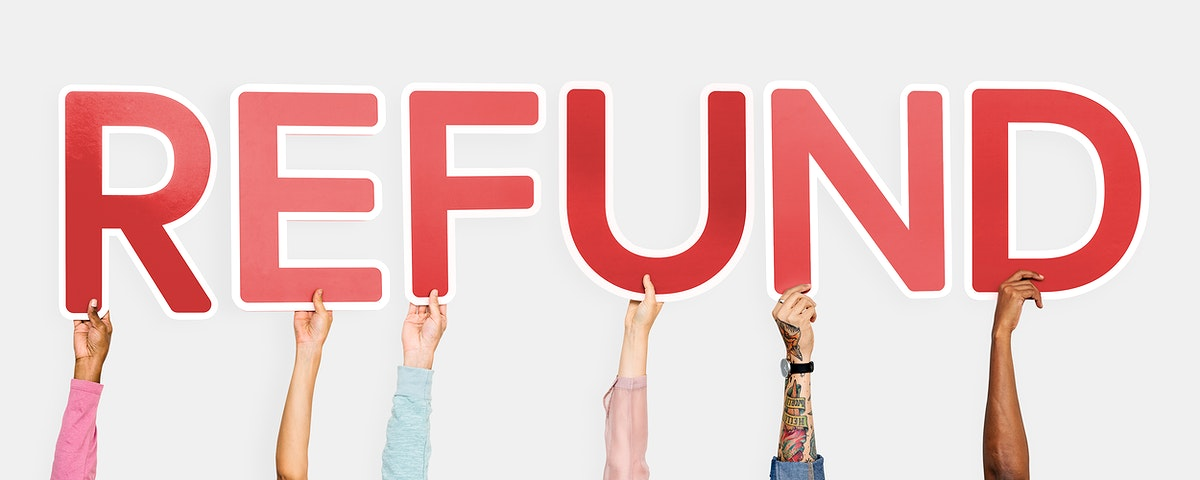 Hands holding up red letters forming the word refund