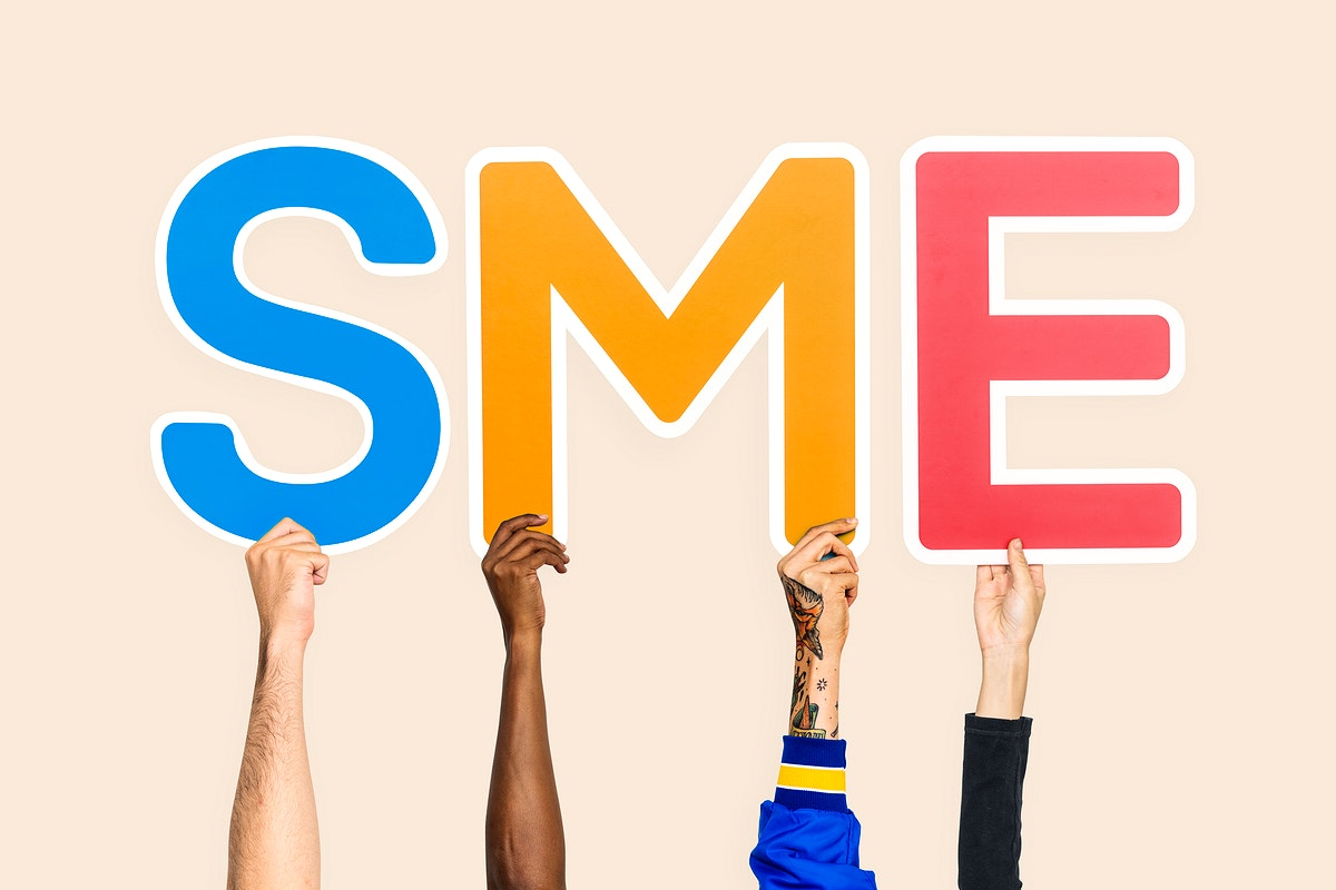 Hands holding up colorful letters forming the abbreviation SME