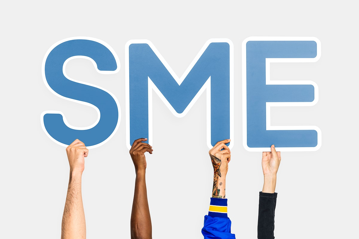 Hands holding up blue letters forming the abbreviation SME