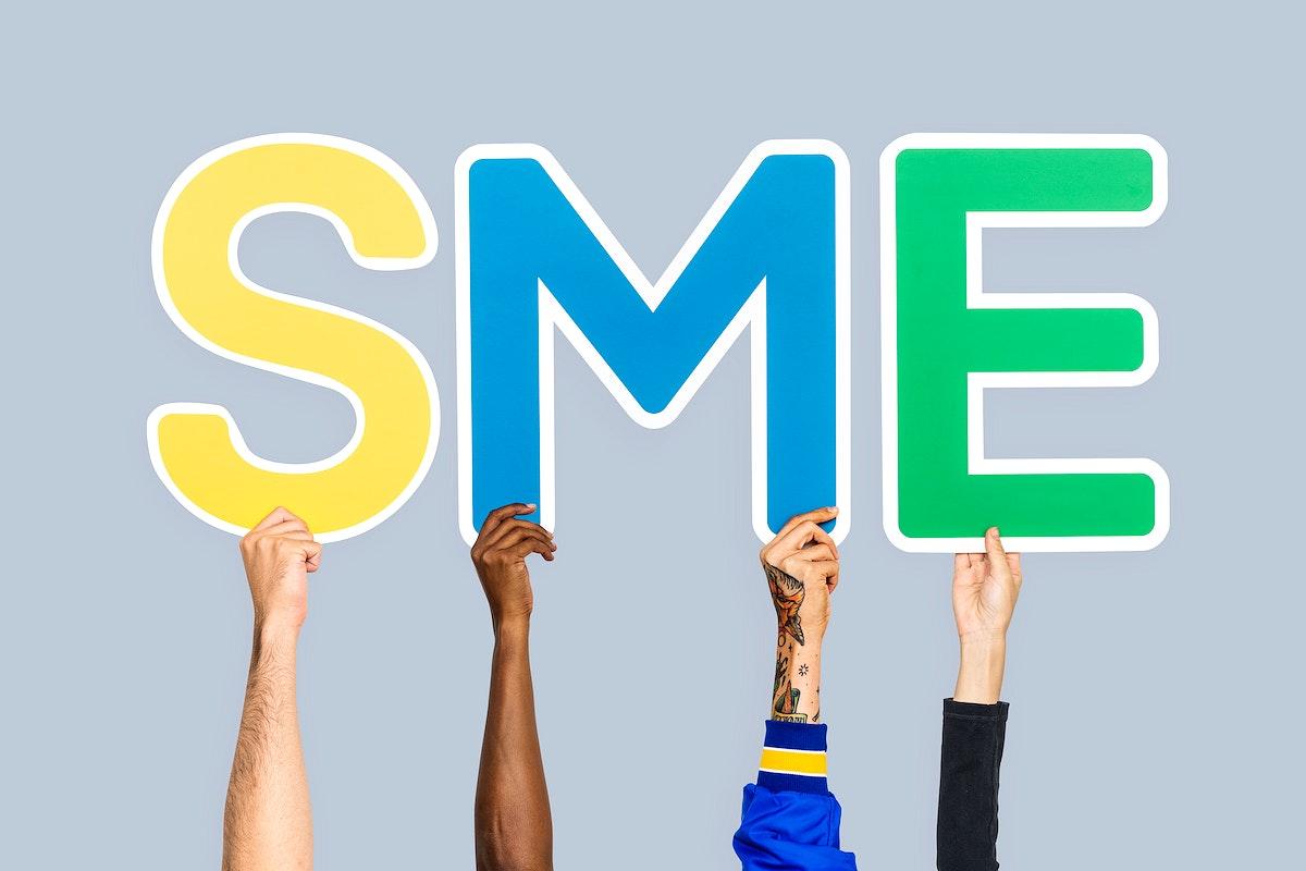 Hands holding the abbreviation SME