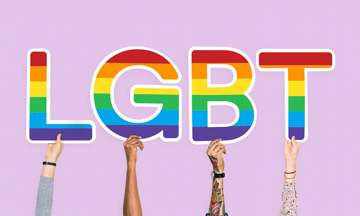 Hands holding the word LGBT
