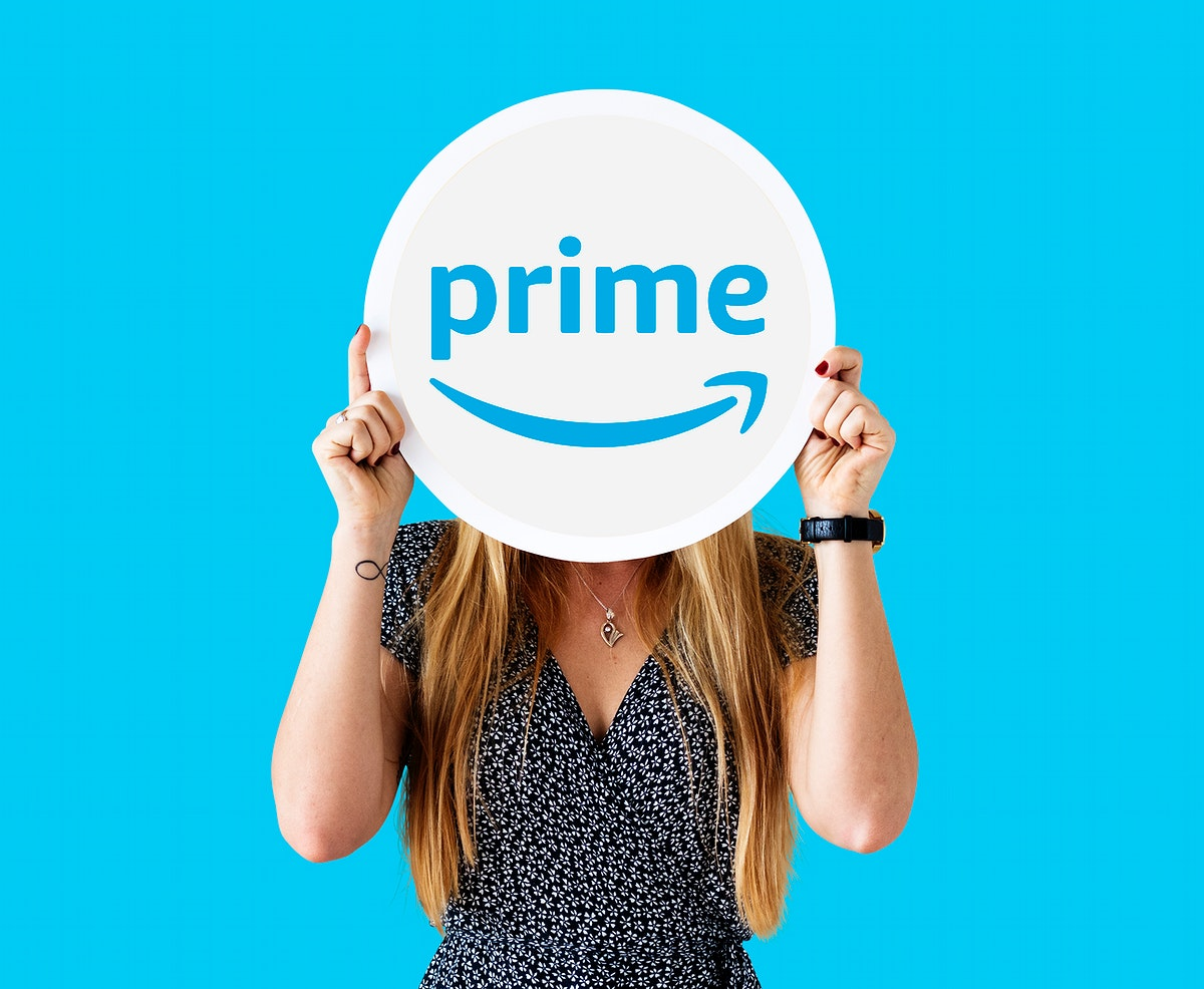 Woman showing a Prime Video sign