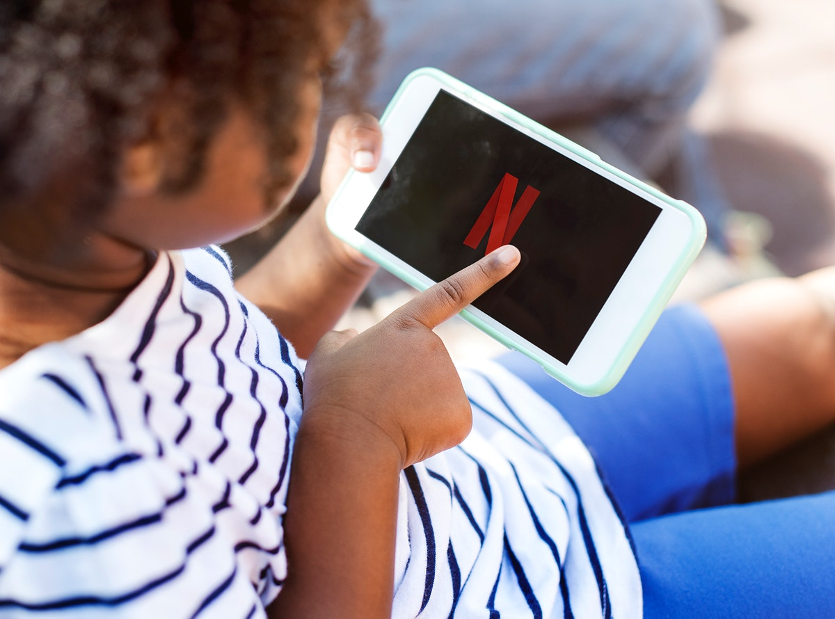 Young kid watching Netflix on a phone