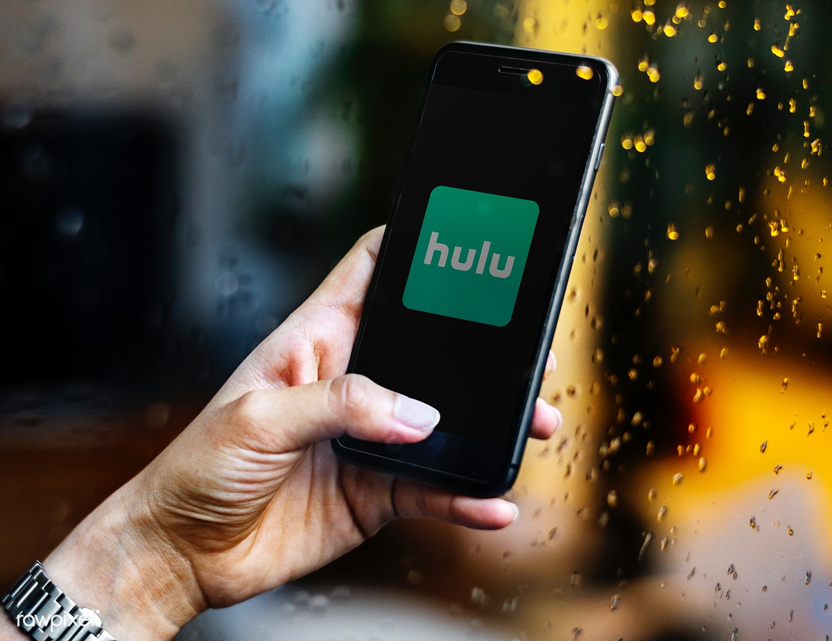 Download premium image of Person watching Hulu on a phone 550637