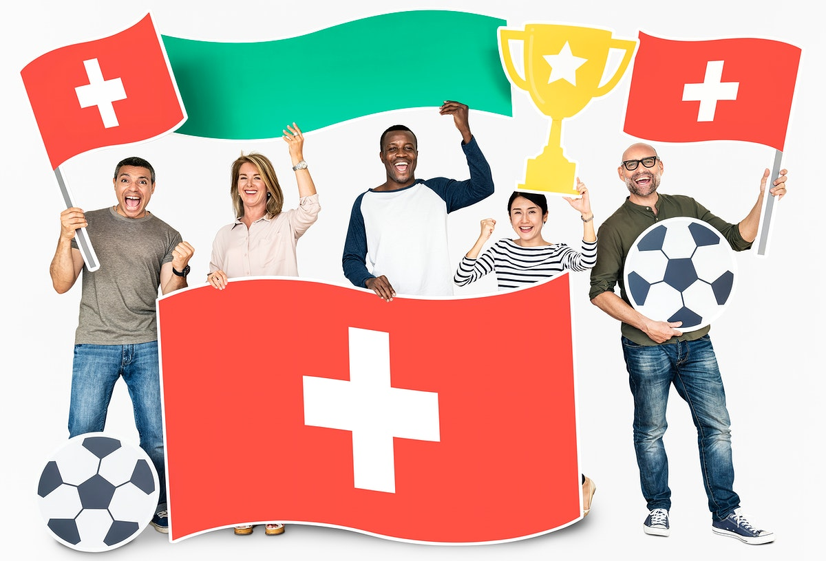 Diverse football fans holding the flag of Switzerland
