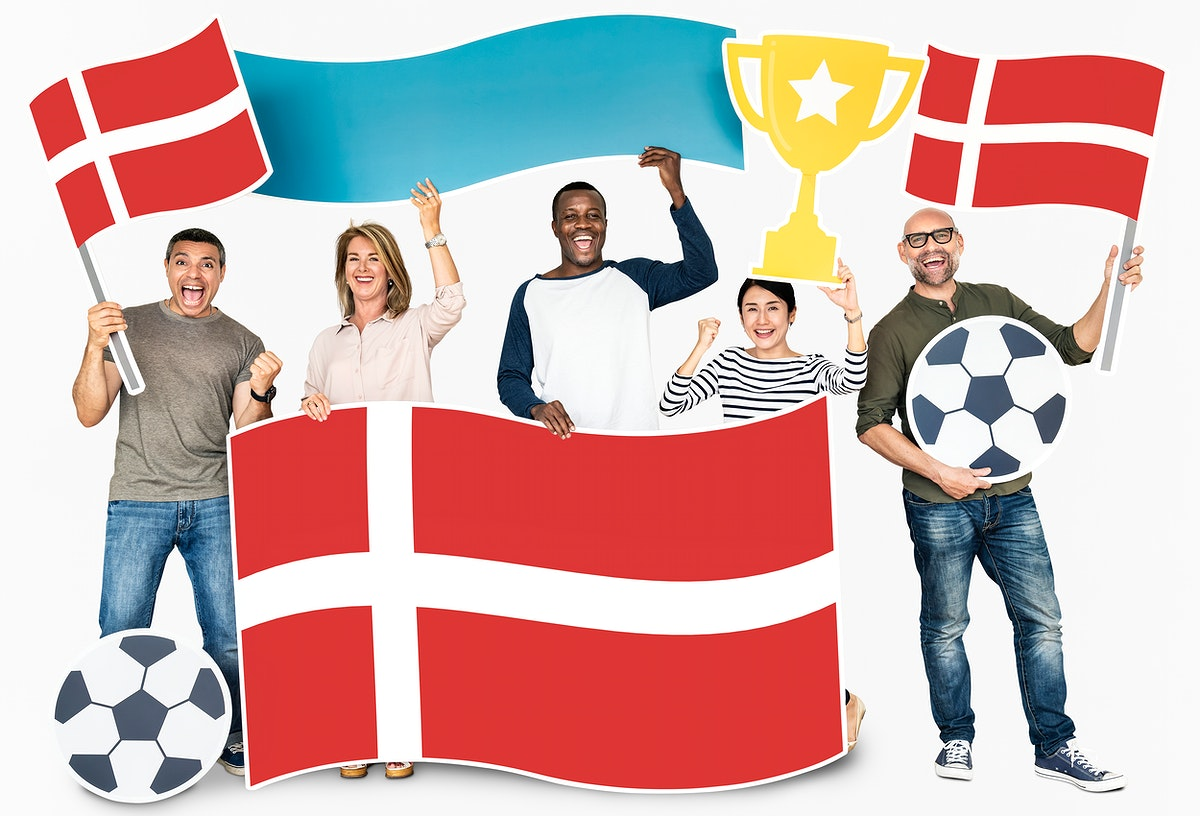 Diverse football fans holding the flag of Denmark