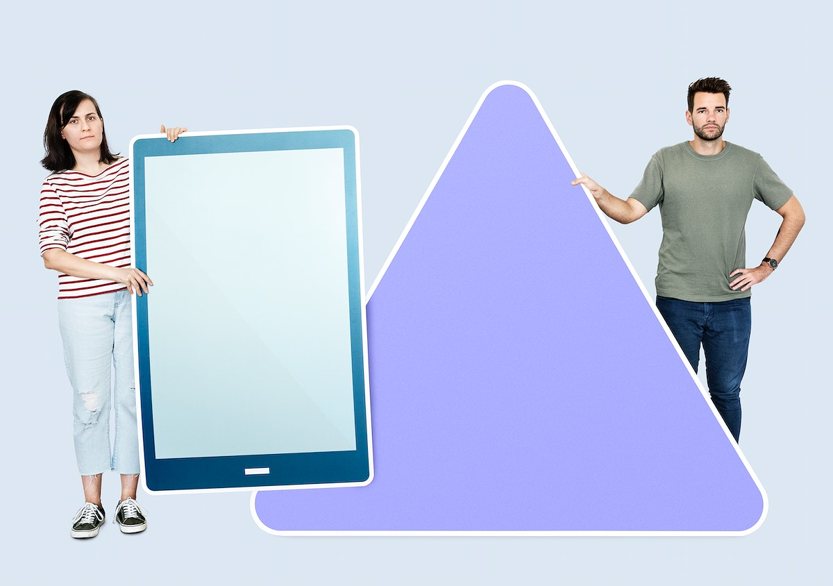 People holding different icons in front of a giant paper cutout