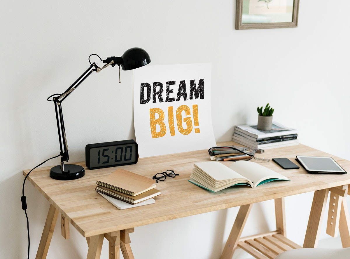 Minimal style workspace with a wording Dream big