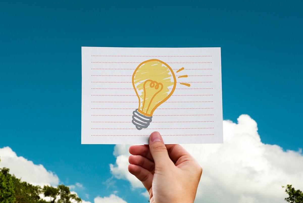Light bulb drawn on a paper