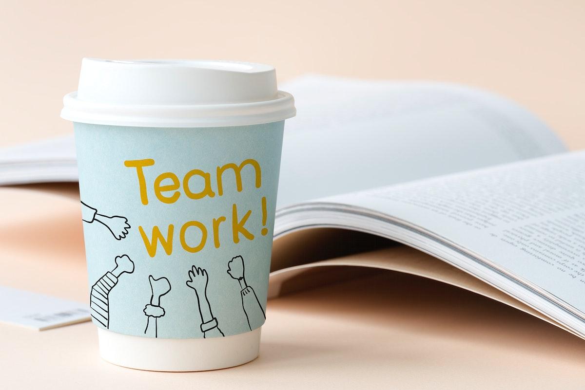 Teamwork written on a paper cup