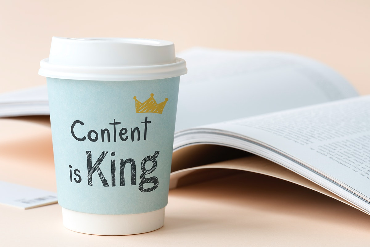 Content is king written on a paper cup