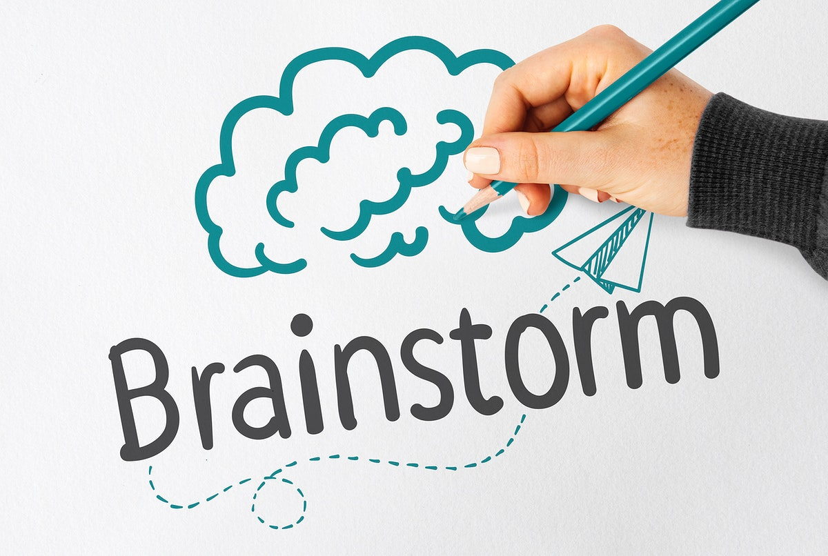 Hand writing Brainstorm on a notebook