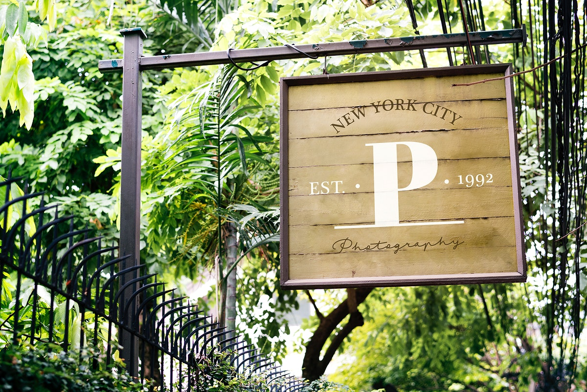 Wooden signboard at a gate mockup