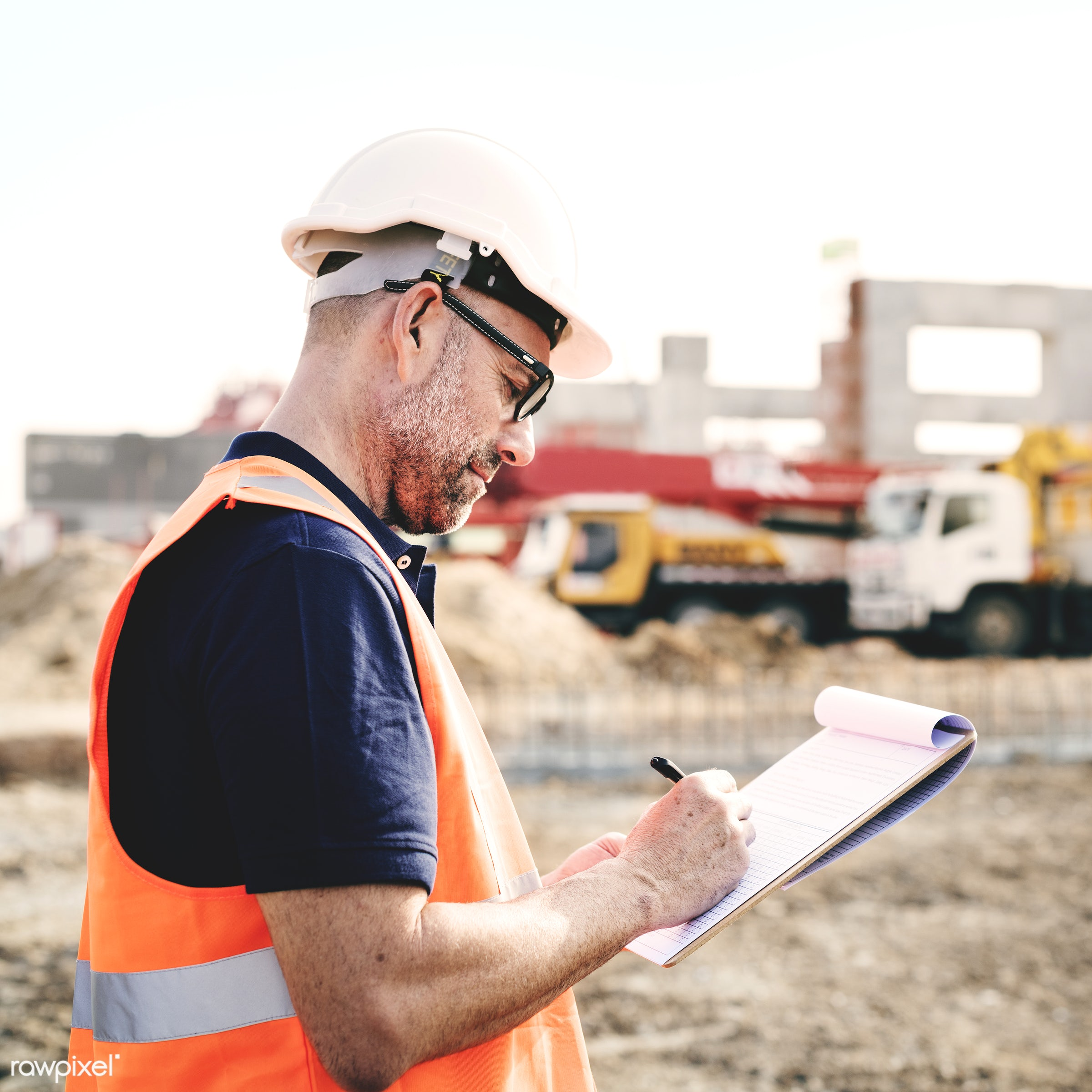 Site engineer on a construction site - construction, worker, building, engineer, project, architecture, blueprint, board,...