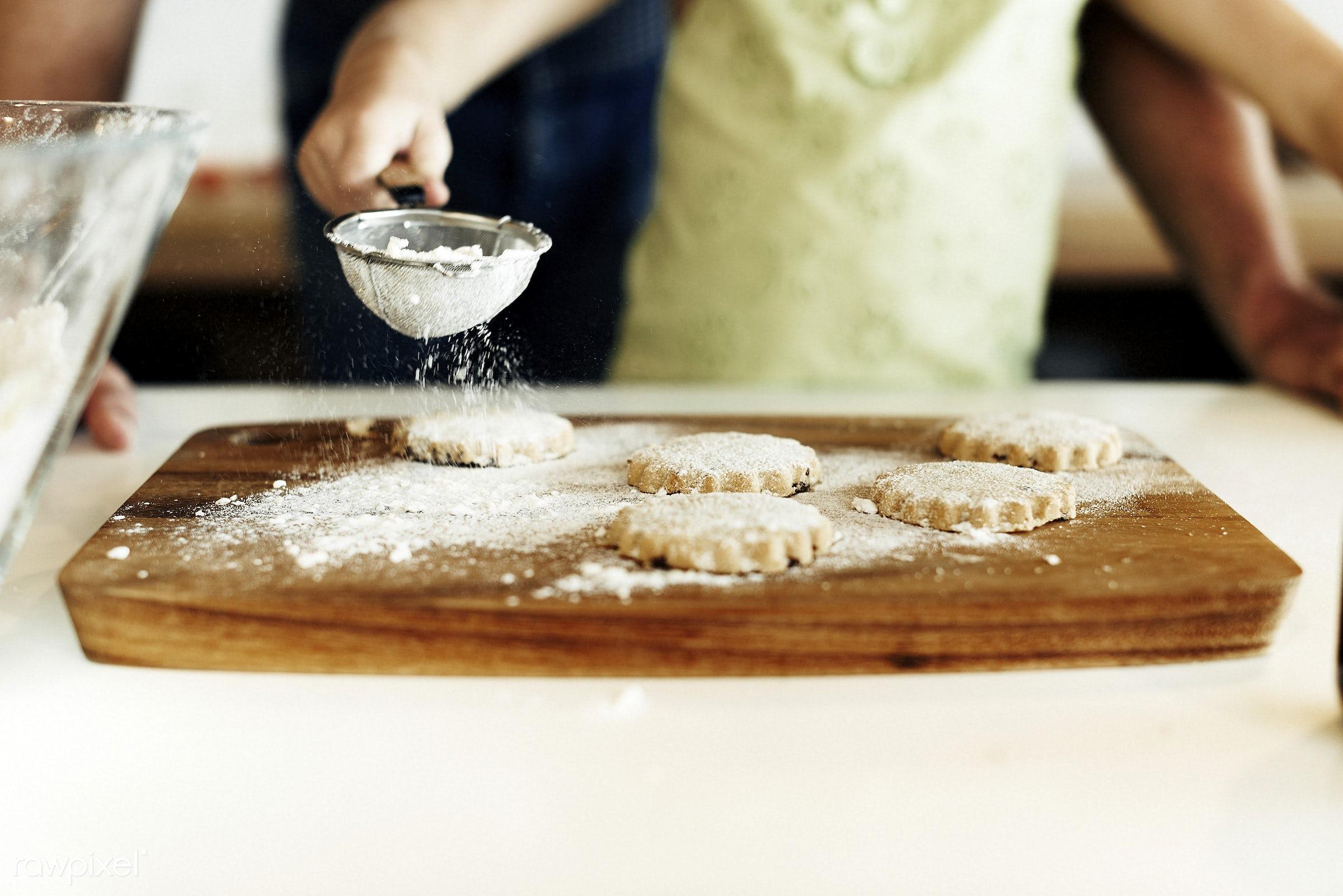 Young caucasian baker - activity, alone, bake, baker, bakery, baking, caucasian, cheerful, child, cook, cookies, dessert,...