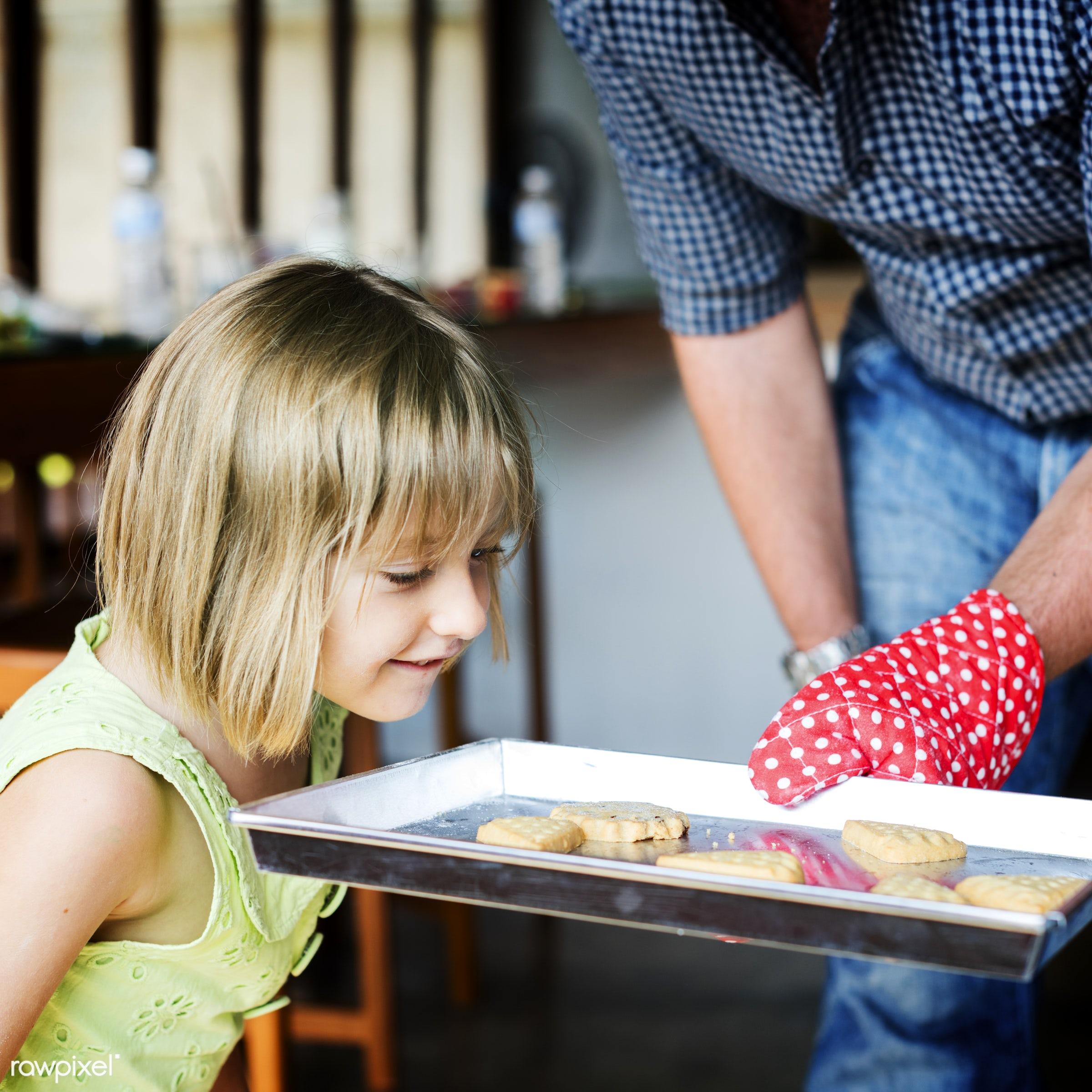 Young caucasian baker - activity, american, bake, baker, bakery, baking, biscuit, blond, child, cookies, dad, daughter,...