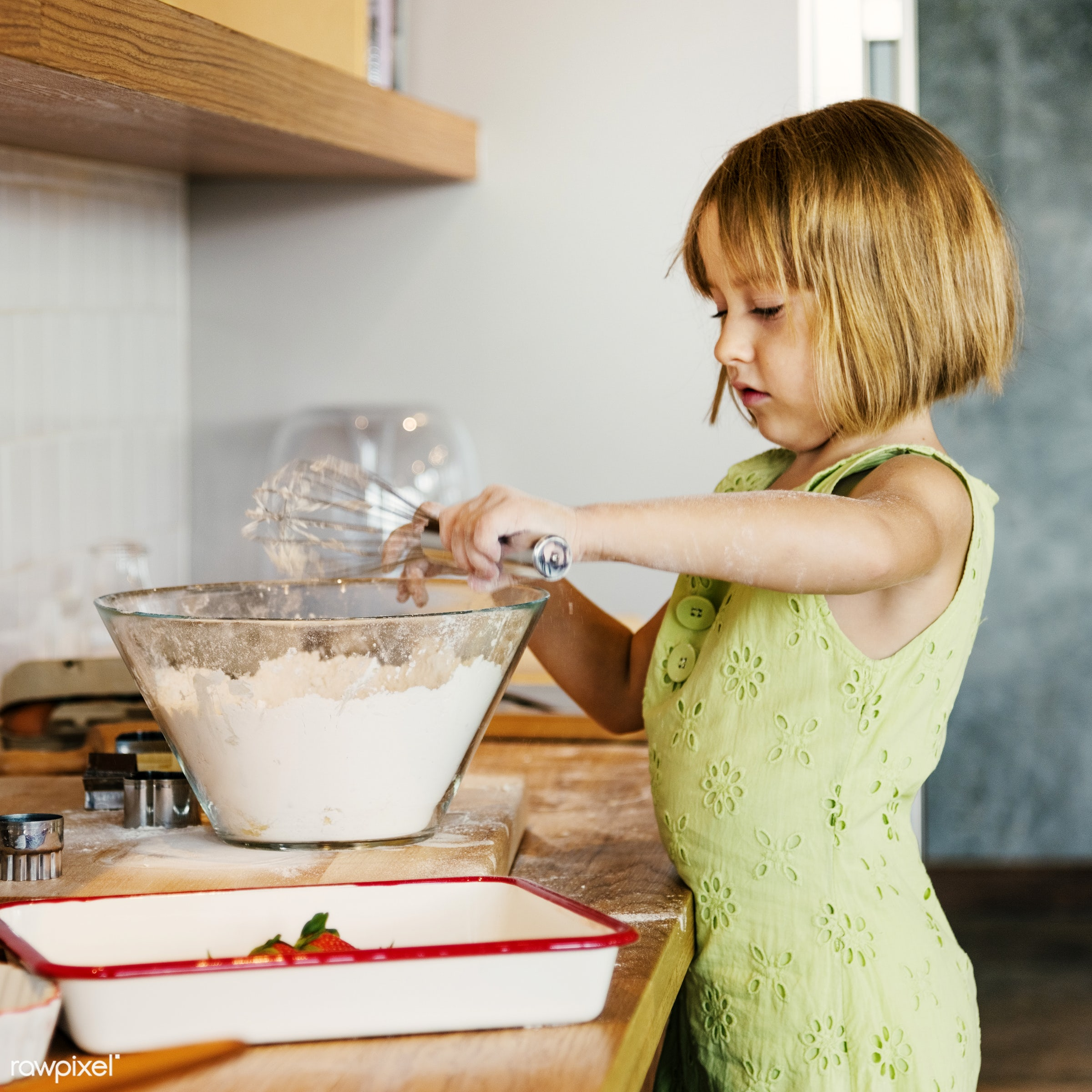 Young caucasian baker - activity, alone, american, bake, baker, bakery, baking, blond, cheerful, child, cook, cookies,...