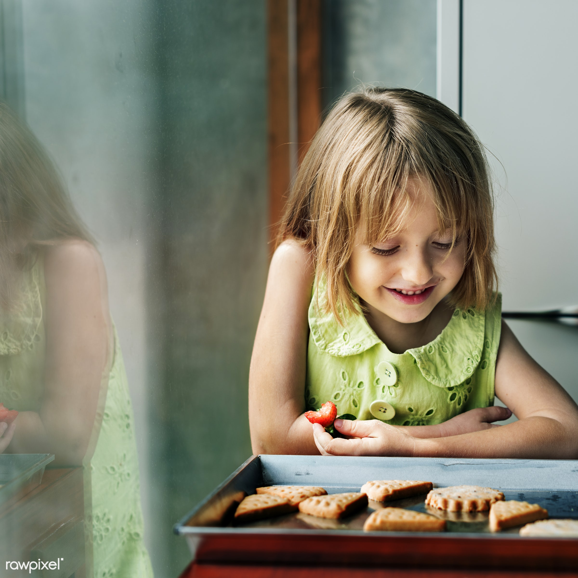 Young caucasian baker - activity, alone, american, bake, baker, bakery, baking, biscuit, blond, child, closeup, cookies,...