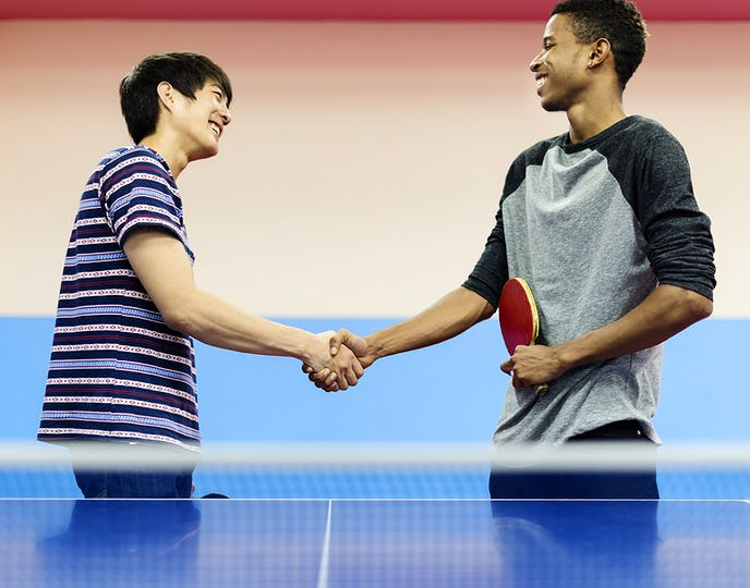 Table tennis players shaking hands