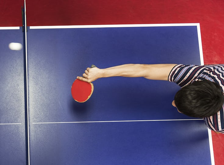 Asian guy playing table tennis