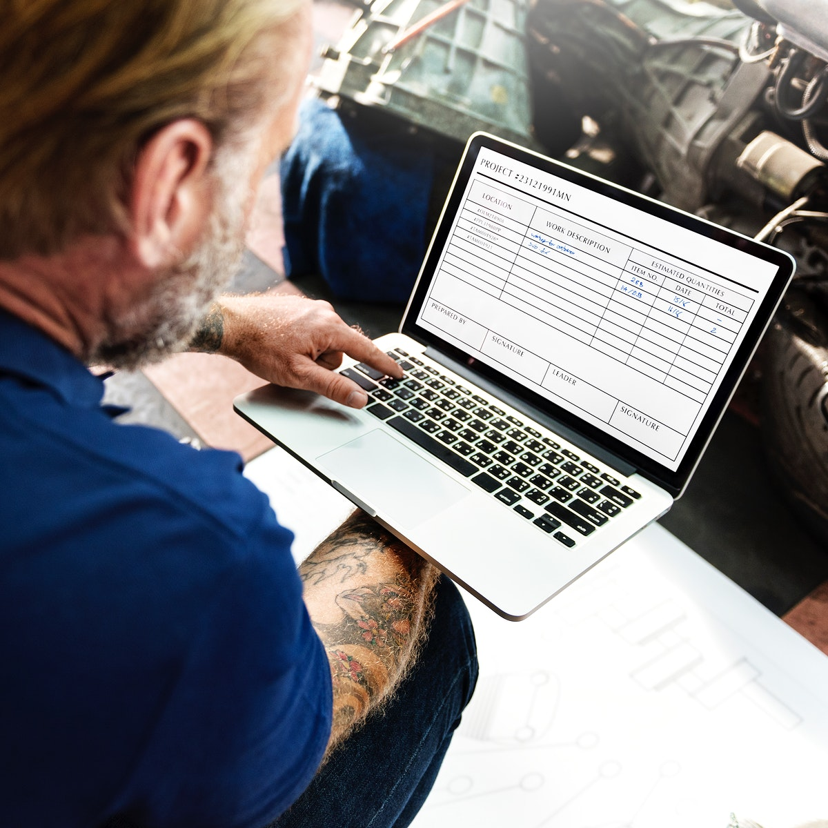 A mechanic working with his laptop