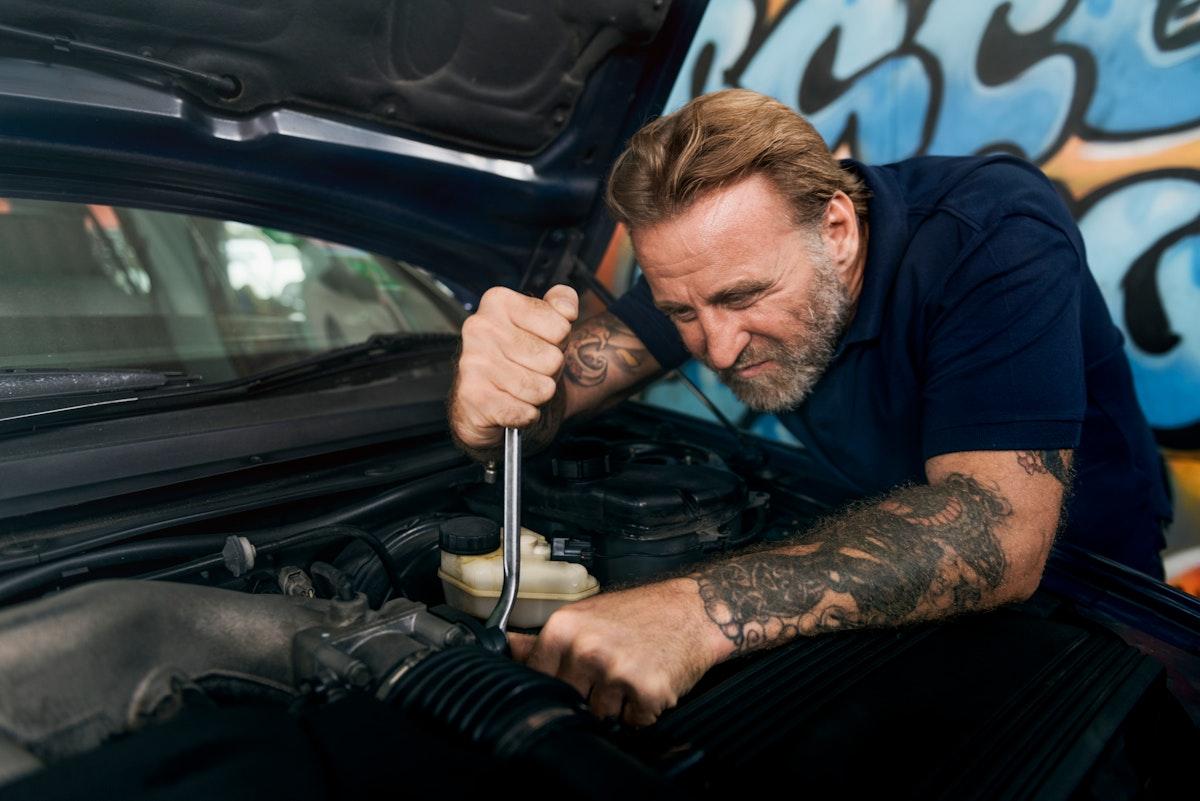 A mechanic fixing a car