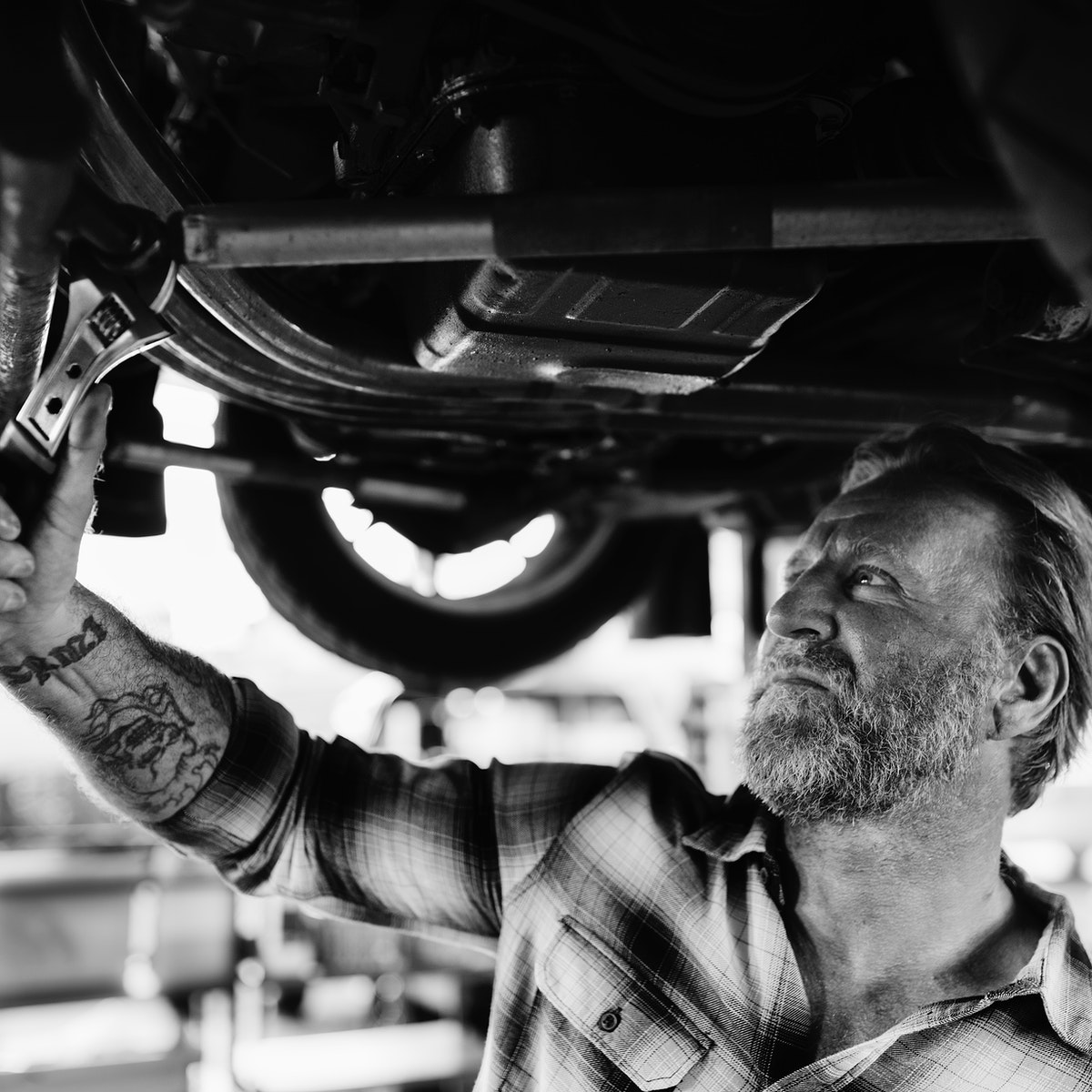 A mechanic holding a wrench